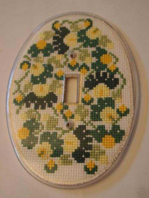 cross stitched light plate cover
