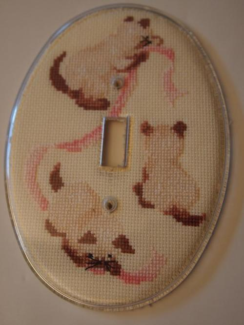 Cross stitched kittens on light plate cover
