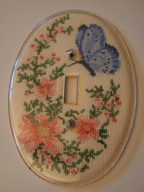 cross stitched light plate cover with butterfly